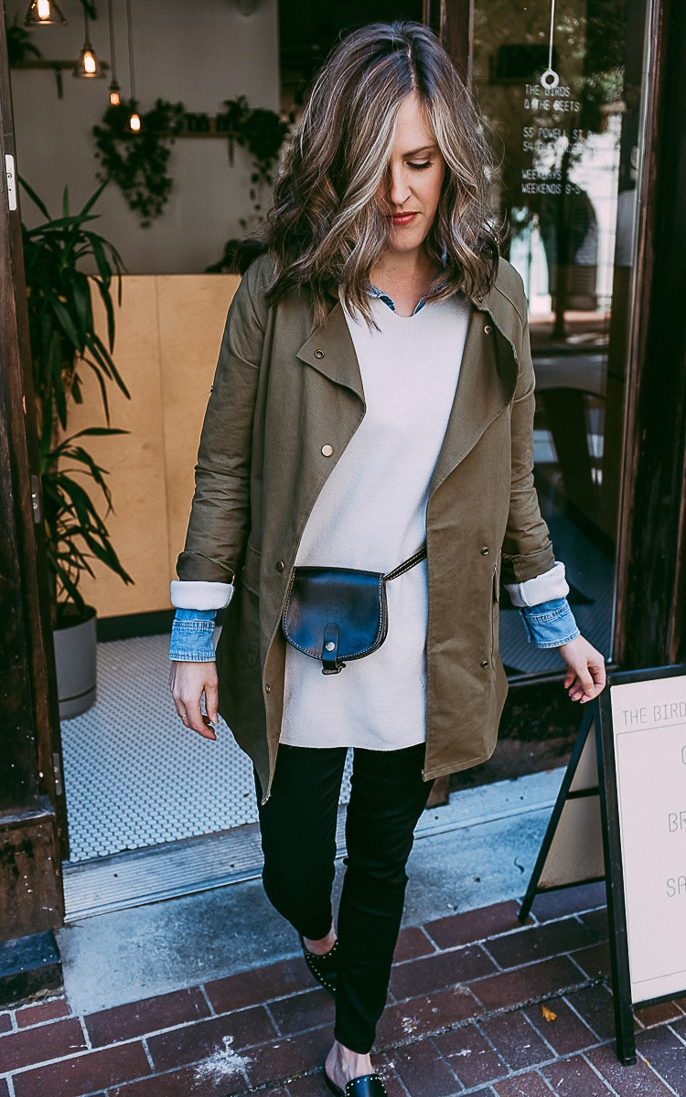 Fall layers with a fannypack, green jacket, jean shirt, and oversized sweater
