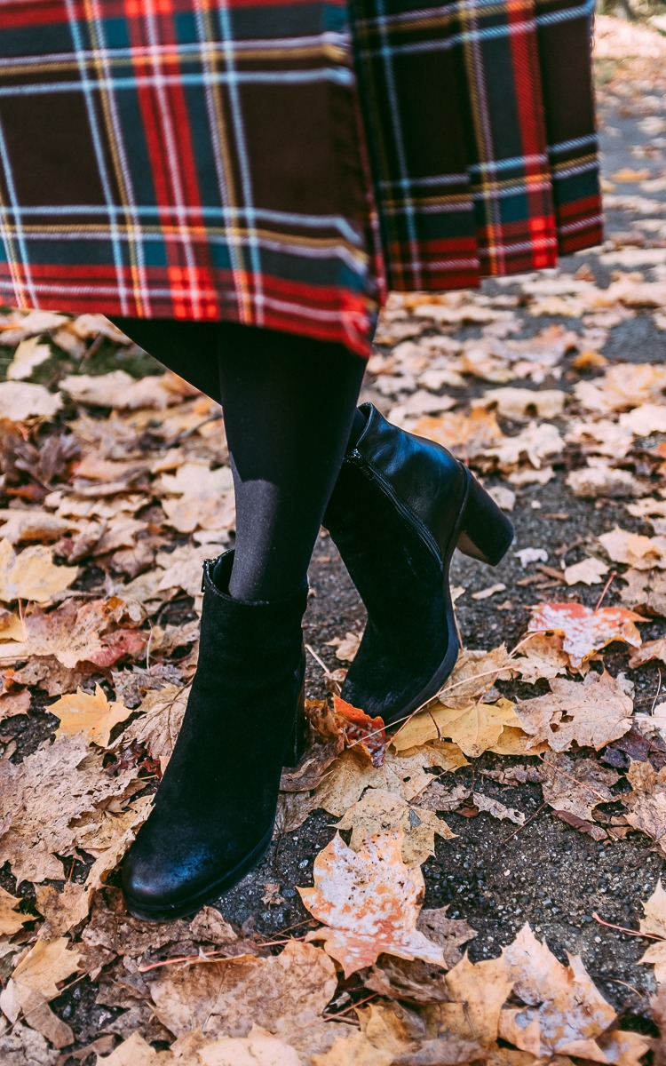 Black boots and plaid skirt for fall