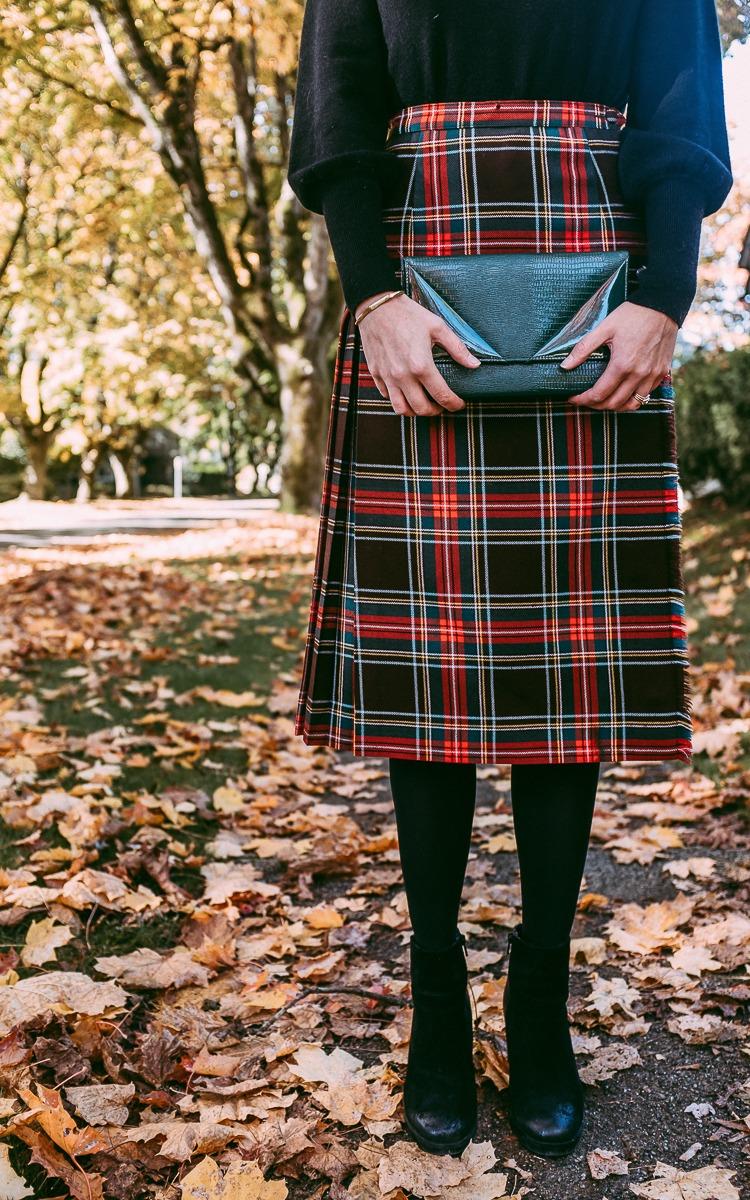 Emerald green clutch and plaid skirt