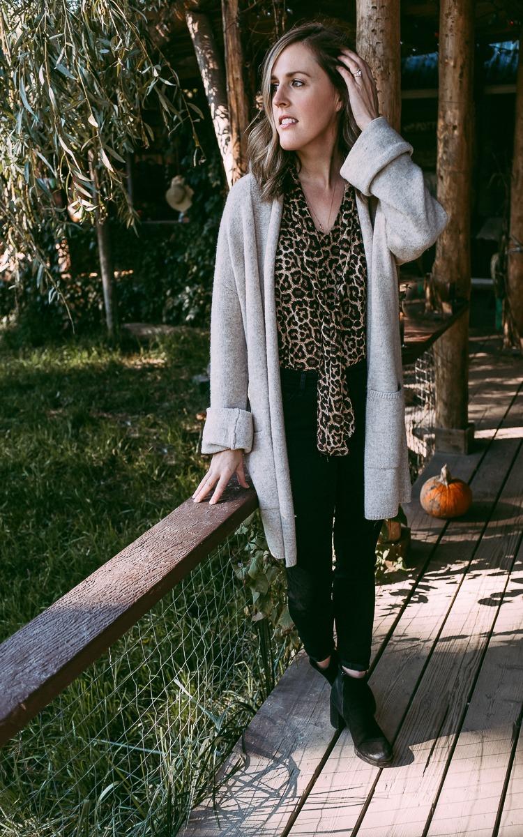 Leopard print shirt and black pants