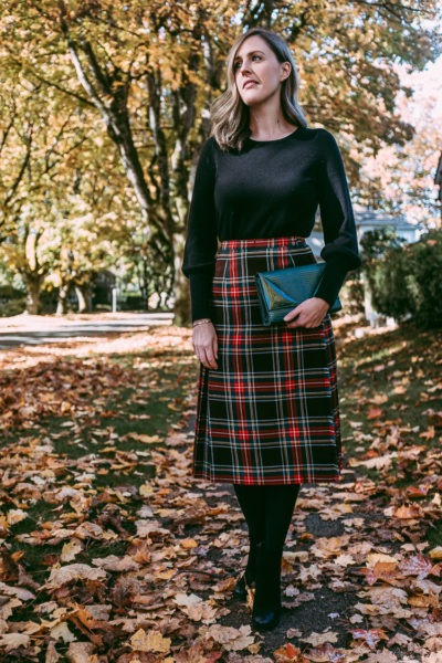 Plaid skirt and emerald green clutch for fall.