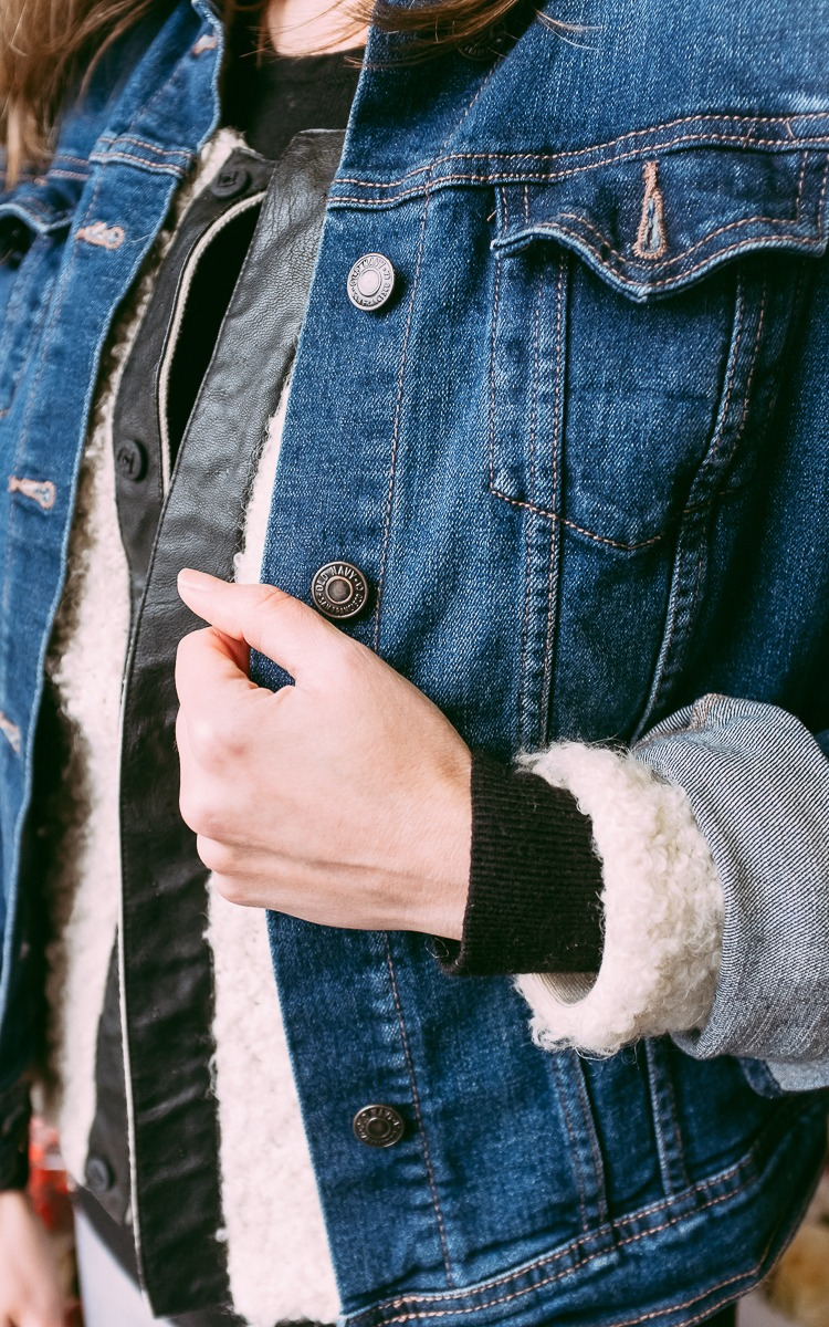 Jean jacket layered for winter.
