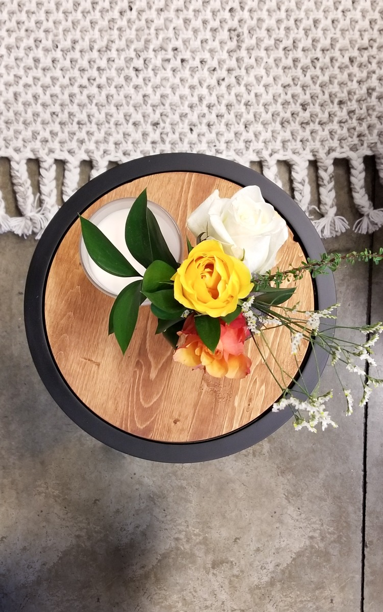Upcycled side tables with flowers and candles