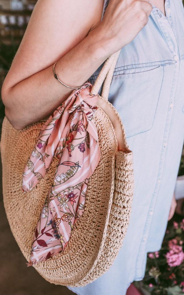 scarf on a straw bag