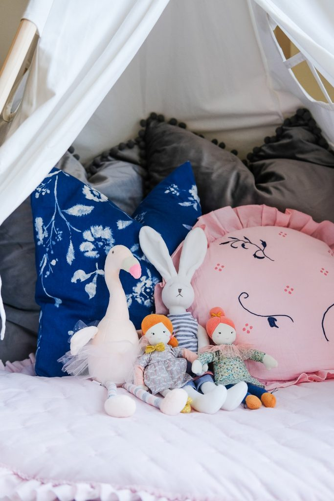 Children's tent with pillows and stuffed animals