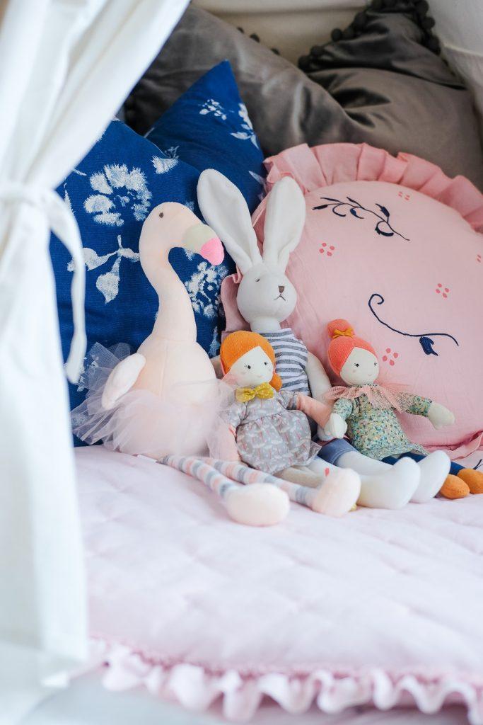 stuffed animals in children's tent