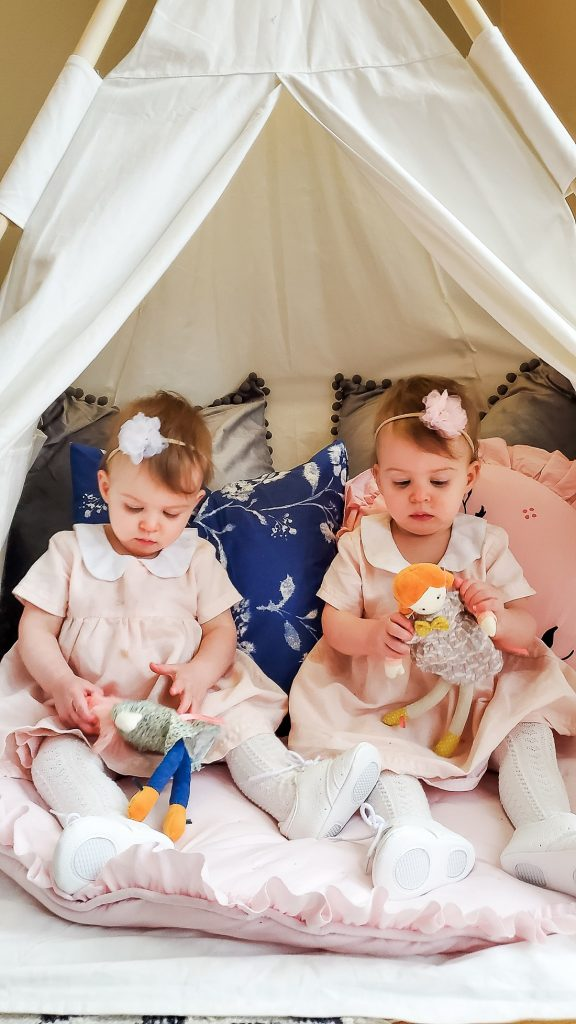 twins playing in tent