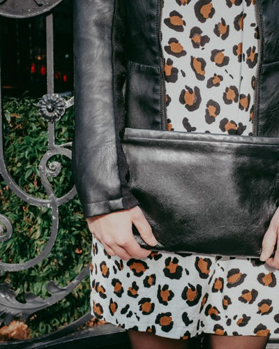 Leather purse, leather jacket and leopard print dress